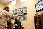 Occupational Therapy students cheers on clients playing Wii bowling at The Buddy Coholan Center in Medford. (Alonso Nichols/Tufts University)