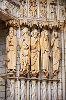 North Porch, Central Portal, left Jambs- General View c. 1194-1230. Cathedral of Chartres, France . Gothic statues of figures, from the left.1) the Old-Testament Priest/King Melchisedech holding a cup..2) Abraham sacrificing Isaac.3) Moses with the brazen serpent and the tablets of the Law.4) Samuel, sacrificing a lamb.5) King David.This portal was cleaned in the 1990's. The cleaning uncovered the yellowish sizing material that at one time served as a base for the paint and gilding which once decorated the figures.. A UNESCO World Heritage Site. .