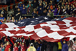 WASHINGTON, DC - MARCH 07: U.S. fans unfurl a large flag during the playing of the national anthem. The United States Women's National Team hosted the France Women's National Team as part of the SheBelieves Cup on March 7, 2017, at RFK Stadium in Washington, DC. France won the game 3-0.