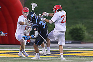 College Park, MD - April 29, 2017: Maryland Terrapins Nick Manis (20) knocks the ball out of Johns Hopkins Blue Jays Shack Stanwick (32) stick during game between John Hopkins and Maryland at  Capital One Field at Maryland Stadium in College Park, MD.  (Photo by Elliott Brown/Media Images International)