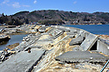 April 1st, 2011, Yamadamachi, Japan - A broken concrete levee stretches as far as eye can see in Yamadamachi, Iwate Prefecture, on April 1, 2011, three weeks after this otherwise sleepy northeastern Japanese fishing vilalge was devastated by a magnitude 9.0 earthquake and ensuing tsunami. (Natsuki Sakai/AFLO) [3615] -mis-.