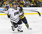 Dalton Speelman (UNH - 10) - The Merrimack College Warriors defeated the University of New Hampshire Wildcats 4-1 in their Hockey East Semi-Final on Friday, March 18, 2011, at TD Garden in Boston, Massachusetts.
