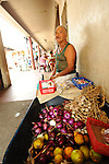 A street vendor sells fruit in the peaceful, hilltop town of Suchitoto, El Salvador..