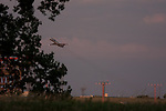 A jet plane takes off from a runway at the Minneapolis/St. Paul Airport