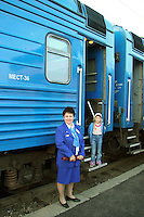 The Provodnitsa is your friendly  carriage attendant.  Besides keeping the bathrooms and corridors clean, and the samovar boiling with water, her job is also to keep track of your tickets - which she will hold for the duration of your journey, and advise passengers of the time at each stop, usually displayed in sign language or pointing at your watch.  While stretching on the platforms, it is rarely a good idea to stray far from the train, and to keep your eye out on the provenitsas for when they want you to get back on the train.  It would be most unlucky to be stuck in a provincial Mongolian or Russian village till the next train. .