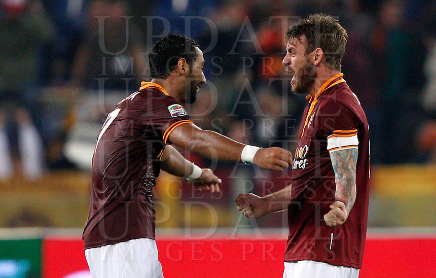 Calcio, Serie A: Roma vs ChievoVerona. Roma, stadio Olimpico, 31 ottobre 2013.<br /> AS Roma defender Mehdi Benatia, of Morocco, left, and midfielder Daniele De Rossi celebrate at the end of the Italian Serie A football match between AS Roma and ChievoVerona at Rome's Olympic stadium, 31 October 2013. AS Roma won 1-0.<br /> UPDATE IMAGES PRESS/Riccardo De Luca