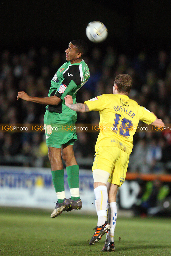 Cristian Montano of Dagenham and Redbridge and Joe Oastler of Torquay -  Torquay United vs Dagenham and Redbridge - at the Plainmoor Stadium - 24/01/12 - MANDATORY CREDIT: Dave Simpson/TGSPHOTO - Self billing applies where appropriate - 0845 094 6026 - contact@tgsphoto.co.uk - NO UNPAID USE.