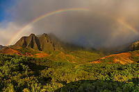 Rainbow over Kalalau valley on the na pali coastline of Kauai.