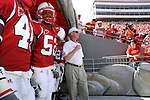 22 September 2007: NC State head coach Tom O'Brien (in white) and his players wait to take the field. The Clemson University Tigers defeated the North Carolina State University Wolfpack 42-20 at Carter-Finley Stadium in Raleigh, North Carolina in an Atlantic Coast Conference NCAA College Football Division I game.