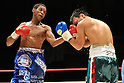 (L-R) Celestino Caballero (PAN), Satoshi Hosono (JPN), DECEMBER 31, 2011 - Boxing : Celestino Caballero of Panama hits Satoshi Hosono of Japan during the WBA featherweight title bout at Yokohama Cultural Gymnasium in Kanagawa, Japan. (Photo by Hiroaki Yamaguchi/AFLO)