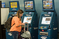 Travelers purchase tickets from ticketing machines in Penn Station in New York  during National Train Day on Saturday, May 10, 2014. Organized by Amtrak and in its seventh year National Train Day endeavors to promote train travel and an understanding of the economic revitalization brought by train travel. (© Richard B. Levine)