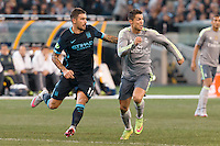 Melbourne, 24 July 2015 - Aleksandar Kolarov of Manchester City and Cristiano Ronaldo of Real Madrid chase the ball in game three of the International Champions Cup match between Manchester City and Real Madrid at the Melbourne Cricket Ground, Australia. Real Madrid def City 4-1. (Photo Sydney Low / AsteriskImages.com)