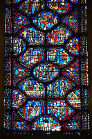 Medieval stained glass Window of the Gothic Cathedral of Chartres, France - dedicated to St Sylvester. A UNESCO World Heritage Site.