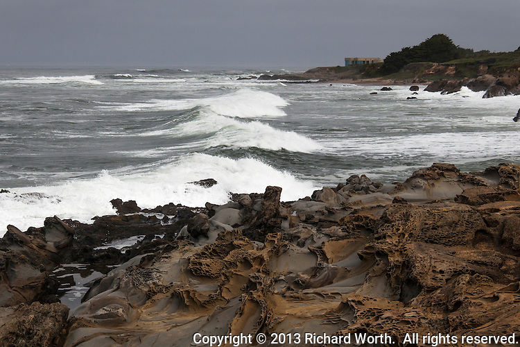 The view from the tafoni formation outcrop at Bean Hollow State Beach as waves roll in to Bean Hollow's <br /> Pebble Beach.