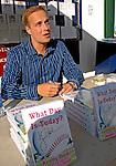 """30 June 2007: Former Vermont Expos pitcher Kenny Beck talks with fans and signs copies of his book """"What Day Is Today?"""" at a game between the Vermont Lake Monsters and the Lowell Spinners at Historic Centennial Field in Burlington, Vermont. Beck m1aintained a journal during his minor league stint in 2002, and recounts the  experiences of a minor league ballplayer trying to move up to the majors. Kenny Beck, currently works as a television news anchor in Salisbury, MD. ..Mandatory Photo Credit: Ed Wolfstein Photo"""
