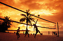 Guam, Micronesia: people playing volleyball on beach in front of resorts at Tumon Bay.