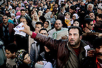 Thousands of Syrian refugees try to escape Libya at the port in Benghazi. Syria has sent ships to pick up their citizens, but there's only room for 1000 in each. Today they sent three ships and tomorrow there will be more. The Syrian government promises that all Syrians will be evacuated. On 17 February 2011 Libya saw the beginnings of a revolution against the 41 year regime of Col Muammar Gaddafi. A man holds his identity documents.