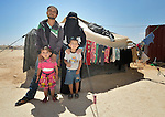 Mamon Al-Hariri and his wife Huda, along with their children Morad, 4, and Hiba, 3, in front of their tent in the Zaatari refugee camp near Mafraq, Jordan. The family fled fighting in Daraa, Syria, in 2013, crossing the border into Jordan without appropriate paperwork. They'd like to move elsewhere, but aren't permitted to leave the camp. <br /> <br /> &quot;There's a big difference between life here and how we lived back home,&quot; said the woman. &quot;We're happy with our neighbors here, but I spend my whole life sitting in a tent when back home I had a beautiful house and garden.&quot;<br /> <br /> Established in 2012 as Syrian refugees poured across the border, the Zaatari camp held more than 80,000 refugees by 2015, and was rapidly evolving into a permanent settlement. ACT Alliance member agencies provide a variety of services to refugees living in the camp.
