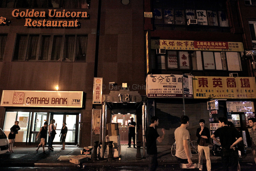 The scene outside of Madam Wong night club. By day Golden Unicorn is a traditional Chinese restaurant, but it is transformed into Madam Wong, a trendy Manhattan club at night. ..Danny Ghitis for The New York Times