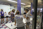 FUSION volunteers at the Explorium helped make a mural out of gum balls on Monday, August 22, 2011 in Lexington, Kentucky.  It was the most participated in FUSION yet with 1,384 volunteers. Photo by Latara Appleby | Staff