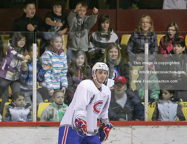 Fans cheers as the Montreal Canadiens practice in Clermont, 150km East of Quebec City, Wednesday October 6, 2010.