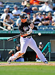 13 March 2012: Miami Marlins infielder Matt Dominguez in action during a Spring Training game against the Atlanta Braves at Roger Dean Stadium in Jupiter, Florida. The two teams battled to a 2-2 tie playing 10 innings of Grapefruit League action. Mandatory Credit: Ed Wolfstein Photo