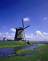 AA00430-03...NETHERLANDS - Windmill on a canal near Amsterdam.