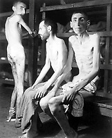 These Russian, Polish, and Dutch slave laborers interned at the Buchenwald concentration camp averaged 160 pounds each prior to entering camp 11 months ago.  Their average weight is now 70 pounds.  Germany, April 16, 1945.  Pvt. H. Miller. (Army)<br /> NARA FILE #:  111-SC-203648<br /> WAR &amp; CONFLICT BOOK #:  1107