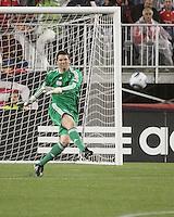 New England Revolution goalkeeper Bobby Shuttleworth (34) kicks a ball deep into midfield.  Portugal's Benfica beat the New England Revolution, 4-0 in a friendly match at Gillette Stadium on May 19, 2010