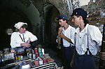 Cheyl Himbert , a Civil War Sutler, talks to Union soldiers Billy Nelson, center, and David Taylor after the Battle of Fort Morgan, Mobile, Al in 2001. Sutlers were merchants who followed the soldiers from camp to camp.  Jim Bryant Photo. @2001. All Rights Reserved.