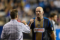 Philadelphia Union manager John Hackworth greets Conor Casey (6) as he is subbed out of the match. The Philadelphia Union defeated D. C. United 2-0 during a Major League Soccer (MLS) match at PPL Park in Chester, PA, on August 10, 2013.