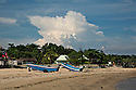 TH00383-00...THAILAND - Storm cloud rising above the Hat Chao Samran Beach.