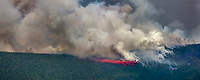 Aircraft attempt to suppress the Hastings wildland forest fire with retardant substance, near Murphy Dome north of Fairbanks, Alaska.