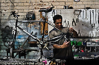A bicycle mechanic assembles a custom made bike in a small scale bicycle factory in Bogota, Colombia, 10 April 2013. Due to the strong, vibrant cycling culture in Colombia, with cycling being one of the two most popular sports in the country, dozens of bike workshops and artisanal, often family-run bicycle factories were always spread out through the Colombian cities. However, growing import of cheap bicycles and components from China during the last decade has led to a significant decline in domestic bicycle production. Traditional no-name bike manufacturers are forced to close down their factories, struggling to survive in the competitive bicycle market.