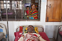 Imran, 30, one of the victims of petrol bomb attack cries in pain as he receives treatment at the Dhaka Medical College hospital in Dhaka, Bangladesh, March 22, 2015. Ten people, including eight workers, suffered burn injuries in a petrol bomb attack on a sand-laden truck at Moghirdhal on the Magura-Jessore road in Sadar upazila on Saturday night.  As the truck reached Moghirdhal around 8:00pm, miscreants hurled a petrol bomb at the vehicle. Soon after the petrol bomb attack, the truck went up in flames, leaving eight workers and the truck driver and his helper burnt.