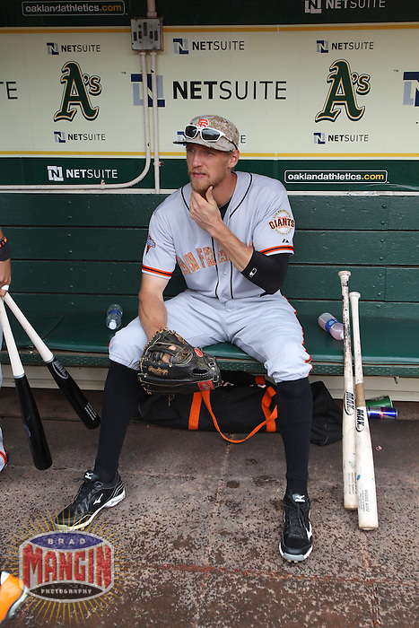 OAKLAND, CA - MAY 27:  Hunter Pence #8 of the San Francisco Giants gets ready in the dugout before the game against the Oakland Athletics at O.co Coliseum on Monday May 27, 2013 in Oakland, California. Photo by Brad Mangin