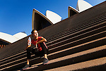 A jogger rests on the steps of the Sydney Opera House.  Sydney, New South Wales, AUSTRALIA.