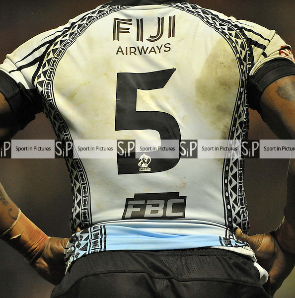The back of Akuila Uate (Fiji) shirt  - PHOTO: Mandatory by-line: Garry Bowden/SIPPA/Pinnacle - Photo Agency UK Tel: +44(0)1363 881025 - Mobile:0797 1270 681 - VAT Reg No: 768 6958 48 - 28/10/2013 - Rugby League World Cup 2013, Fiji v Ireland, Spotland Stadium, Rochdale, England