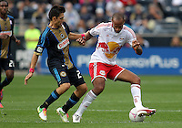 CHESTER, PA - OCTOBER 27, 2012:  Michael Farfan (21) of the Philadelphia Union holds  Thierry Henry (14) of the New York Red Bulls during an MLS match at PPL Park in Chester, PA. on October 27. Red Bulls won 3-0.