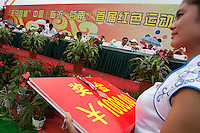 Hostesses wait to hand over medals and winners cheques to competitors at the Red Games. Held in Junan County, this sporting event is a nostalgic tribute to the communist era.