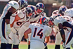 Oakland Raiders vs. Denver Broncos at Oakland Alameda County Coliseum Sunday, September 17, 2000.  Broncos beat Raiders  33-24.  Denver Broncos quarterback Brian Griese (14) in the huddle.