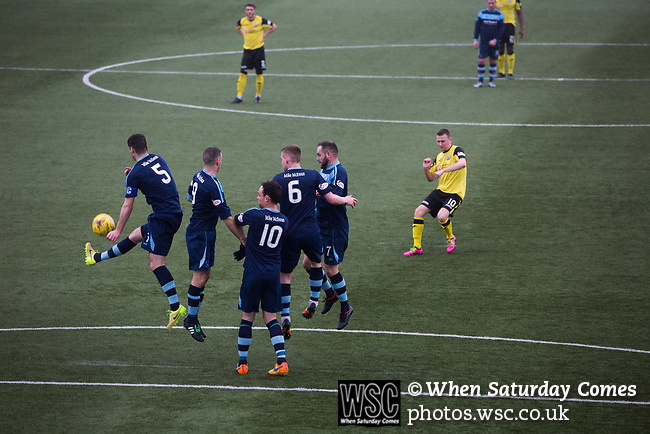Forfar Athletic 1 Edinburgh City 2, 02/02/2017. Station Park, SPFL League 2. Debutant Derek Riordan fires in a free-kick during the first-half at Station Park, Forfar during the SPFL League 2 fixture between Forfar Athletic and Edinburgh City (yellow). It was the club's sixth and final meeting of City's inaugural season since promotion from the Lowland League the previous season. City came from behind to win this match 2-1, watched by a crowd of 446. Photo by Colin McPherson.