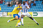 Kilmarnock v St Johnstone....03.03.12   SPL.Fran Sandaza is blocked by Sissoko.Picture by Graeme Hart..Copyright Perthshire Picture Agency.Tel: 01738 623350  Mobile: 07990 594431