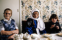 France 1989 <br /> Kurds invitated for tea in an house of Bourg-Lastic    <br /> France 1989  <br /> Kurdes invites chez des habitants de Bourg-Lastic