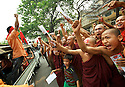 A man incites a group of monks. Monks have always been an essential contribution to the NLD fight for freedom. Mandalay, Myanmar. 2012