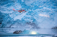A helicopter flown by operator Lufttransport for the Govenor of Svalbard (Sysselmannen), flying in front of the Nordenskiold glacier. <br /> <br />  Using two AS332 L1 Super Puma helikopters they are tasked with Search and Rescue (SAR) and supporting the Governors office overseeing the Svalbard area.