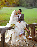 A bride and groom kiss after marrying in the Emmanuel Church in Coloma, California.