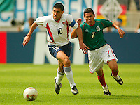 Claudio Reyna holds off Ramon Morales for the ball. The USA defeated Mexico 2-0 in the Round of 16 of the FIFA World Cup 2002 in South Korea on June 17, 2002.