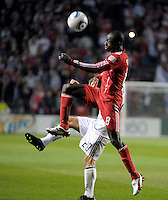 Chicago midfielder Dominic Oduro (8) goes up for the ball in front of Vancouver midfielder Davide Chiumiento (20).  The Chicago Fire tied the Vancouver Whitecaps 0-0 at Toyota Park in Bridgeview, IL on May 7, 2011.