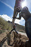 1604-30 211<br /> <br /> Y mountain lighting project<br /> Digging trench and laying conduit for electrical wiring<br /> <br /> April 13, 2016<br /> <br /> Photography by: Mark A. Philbrick/BYU Photo<br /> <br /> Copyright BYU Photo 2016<br /> All Rights Reserved<br /> photo@byu.edu (801)422-7322<br /> <br /> 1848